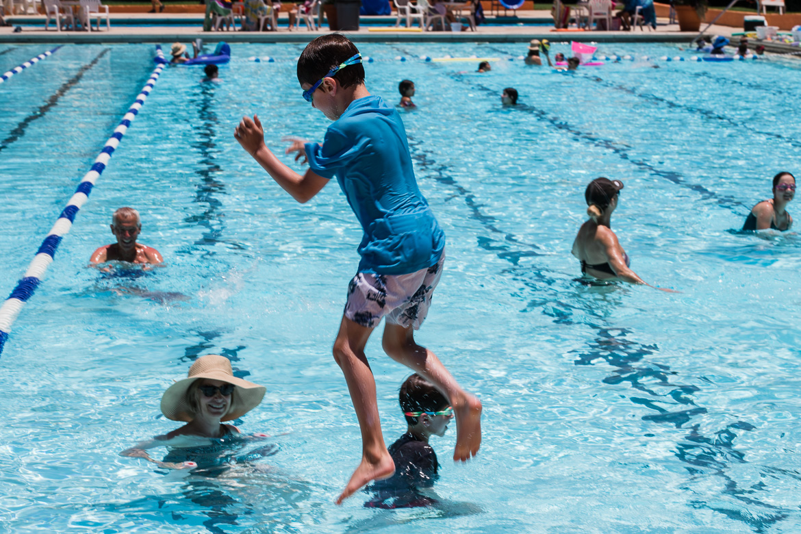 Boy jumps in the Alamo Heights Swimming Pool