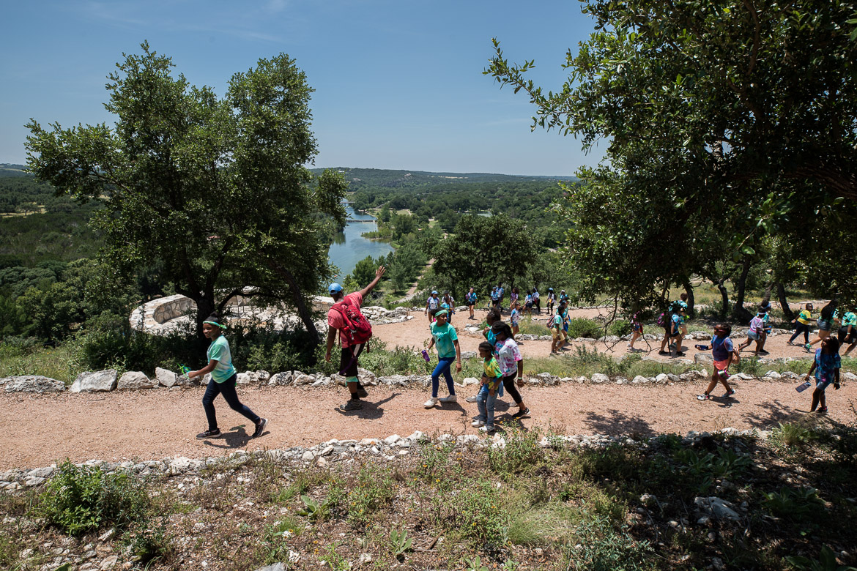 Camp Organizer Alex Bailey waves to Camp Founder Girls below on June 19, 2019.