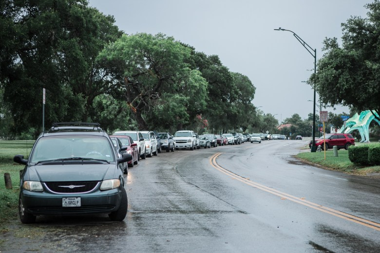 The line of cars waiting to receive food distribution from the San Antonio Food Bank at Woodlawn Lake Park on June 11, 2019.