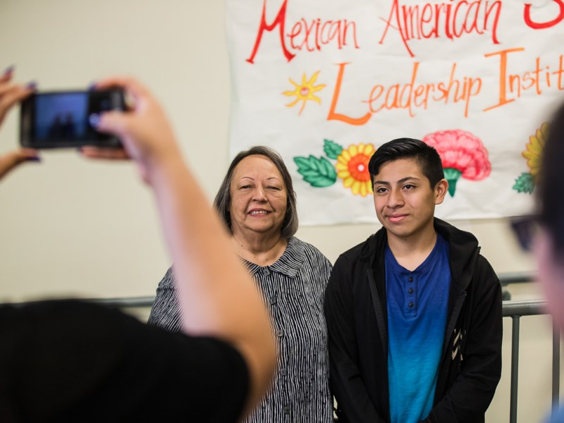 A student participating in the Mexican American Studies camp poses with guest speaker Rosie Castro on June 14, 2019.