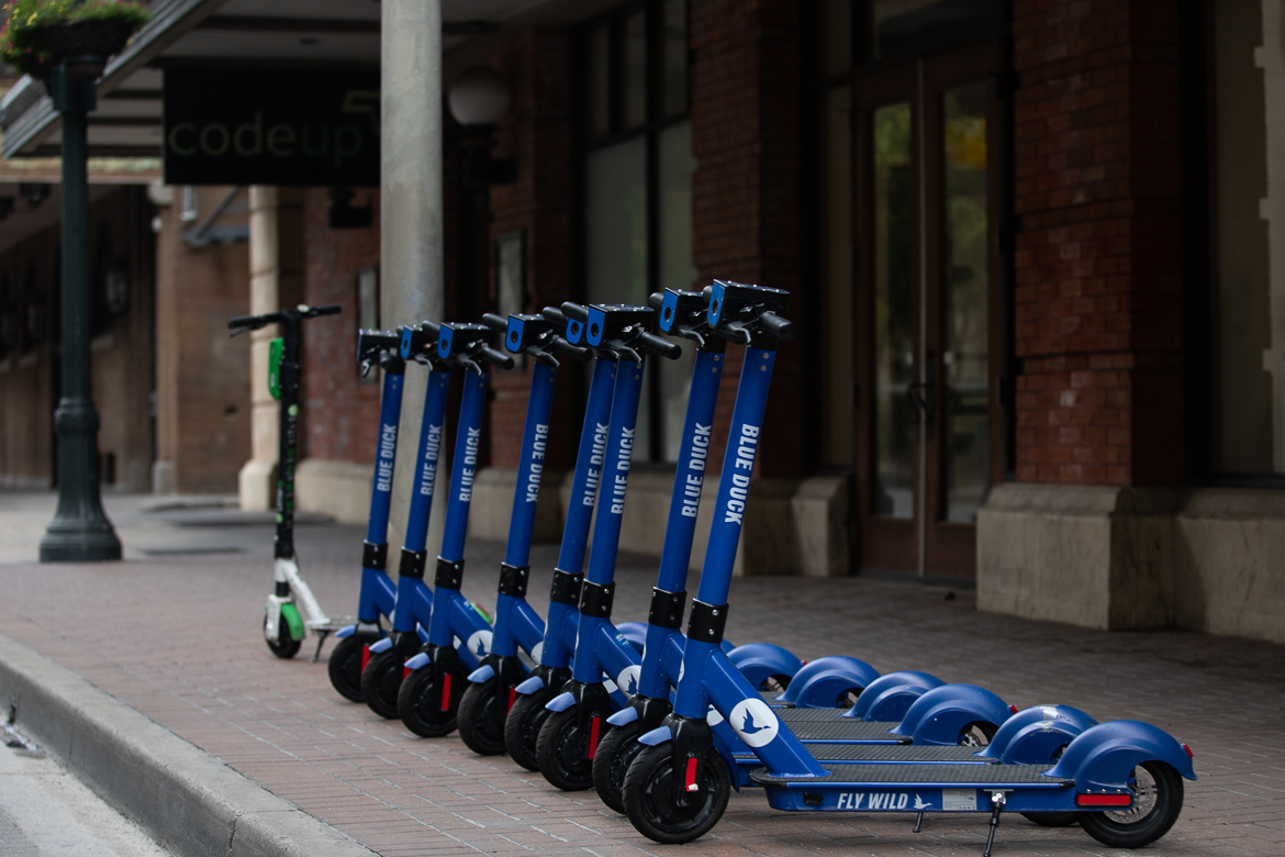 Blue duck scooters downtown on June 25, 2019.
