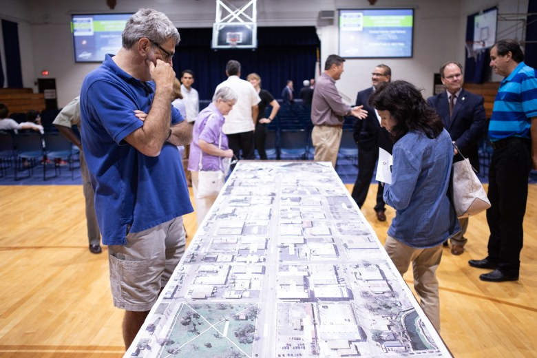 People gather around the proposed designs for the Broadway corridor lower segment.
