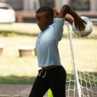 Jeremy Mark, 11, gears up to throw the soccer ball back into the playing area.