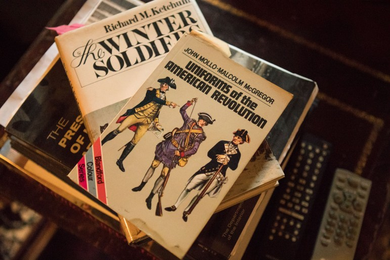 The books in Tom Wetzler's living room are primarily about the American Revolution.