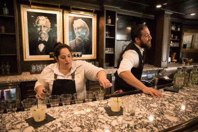 Bartender Angel De La Vega (left) and tasting room manager Ray Guevara serve Maverick Mules to guests.