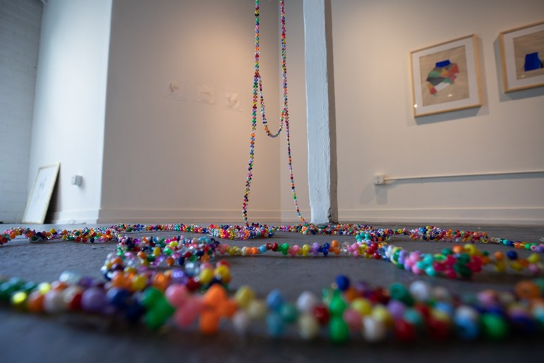"A section of Barbara Miñarro's ""La escalera"" 2019 Plastic beads at Flight Gallery on July 2, 2019."