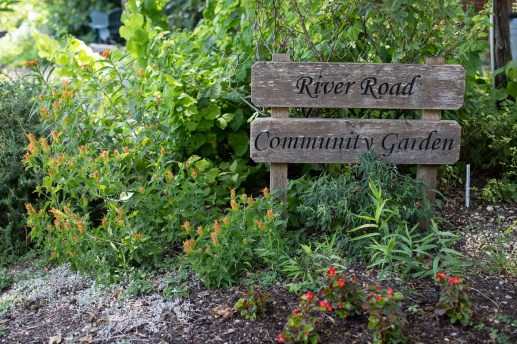 The sign at the River Road Community Garden entrance.