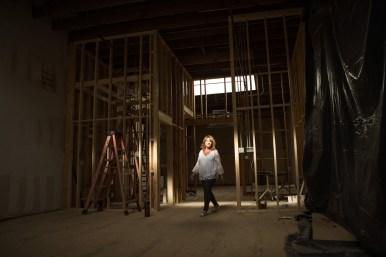Miriam Jones walks through the unfinished showroom.