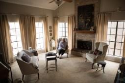 Deborah Sibley sits in her living room.