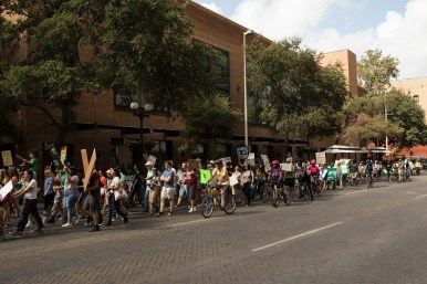 Hundreds chant for climate action during the march down West Market Street.
