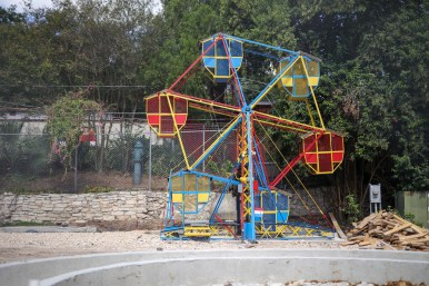 Rides moved from Kiddie Park's former location on Broadway are being installed at the San Antonio Zoo.