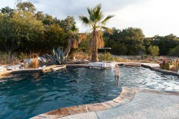 The swimming pool where the Falks stay cool during the summer at their home off of Smithson Valley Road.