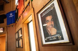 A photo of Chris Madrid is displayed on the wall.