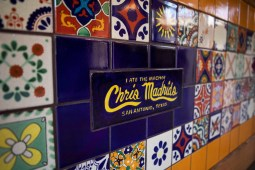Chris Madrid's logo is incorporated into the tile pattern on the front counter.