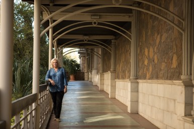 Cathey Meyer stands in the breezeway to her home at La Cascada Condominiums.