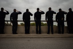 San Antonio Firefighters salute the passing procession.