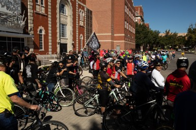 Cyclists gather at the University of the Incarnate Word before riding south on Broadway Street.