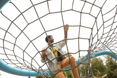 David Robinson Jr. climbs a rope structure in Yanaguana Garden.
