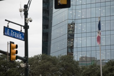 The Robert E. Lee Apartments are reflected in Frost Tower.