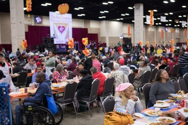 Attendees enjoy a meal at the 40th annual Raul Jimenez Thanksgiving Dinner.