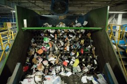Recycled materials continue on their journey toward the compactors.