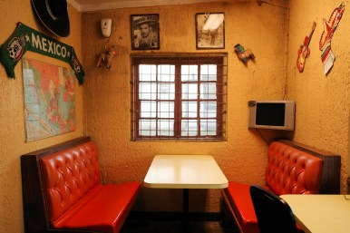 A small space to wait and dine is tucked into a corner at B&B Tamales.