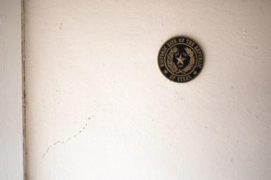 A seal marking the historic designation of Josephine's home near Mission Espada.