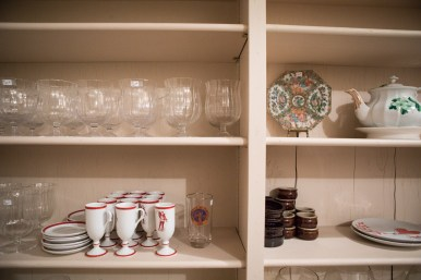 Items for sale line the shelves of a pantry.