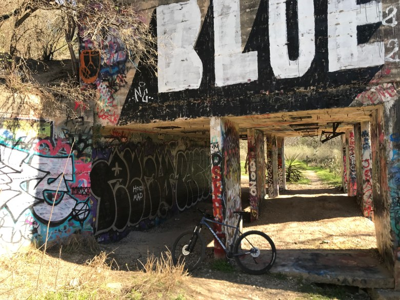 Street Art adorns concrete buildings integrated into the Limbo Trail at Devil's Den.