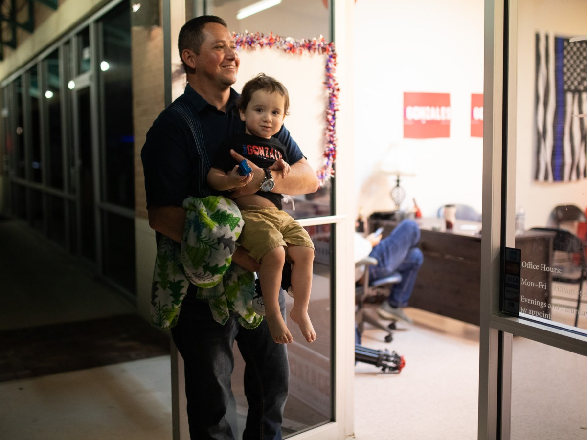 Tony Gonzales, a Republican candidate for Congressional District 23 carries his son Daniel, 2, from his campaign headquarters following election night in March.
