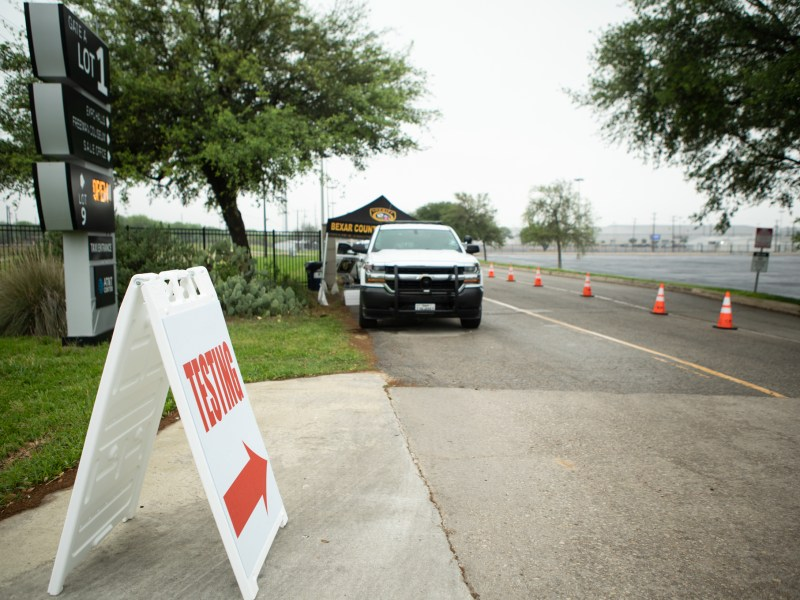 A sign directs people to the entrance of the coronavirus testing site at Freeman Coliseum.
