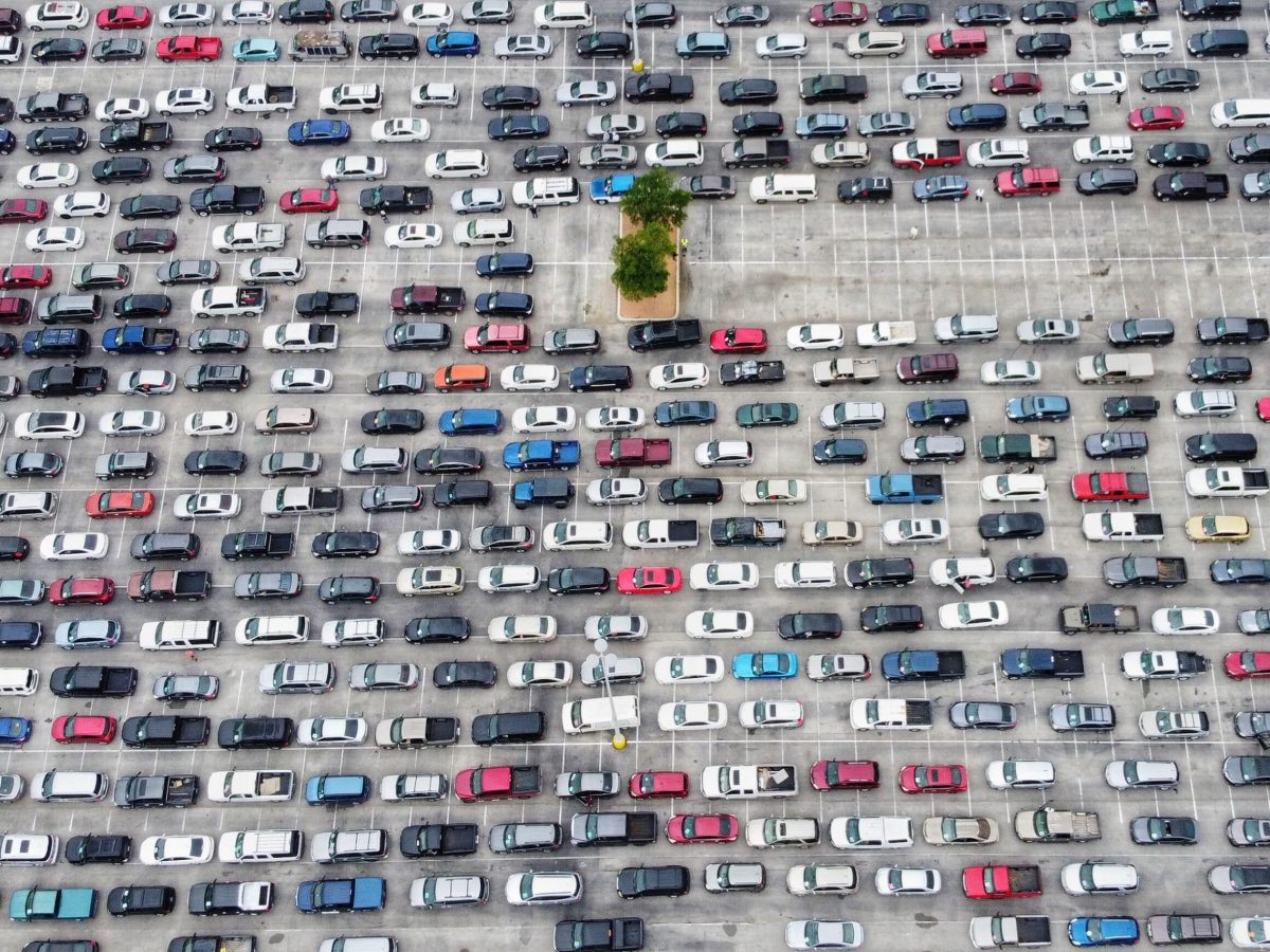 """An aerial view of the San Antonio Food Bank's """"mega distribution"""" site Friday shows vehicles lined up by the hundreds in the Alamodome parking lot to pick up two weeks' worth of groceries."""