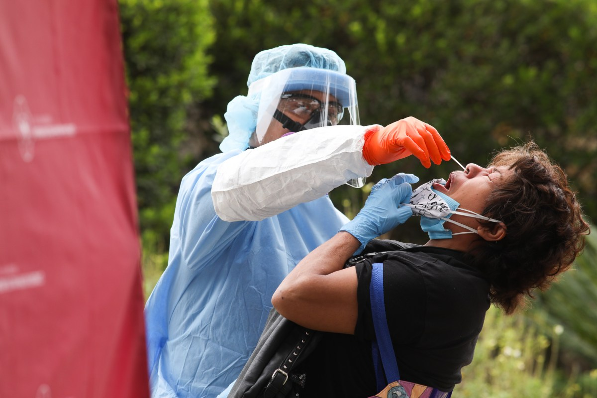 Maria Gonzales, 56, is tested for COVID-19 at Woodlawn Lake Park.