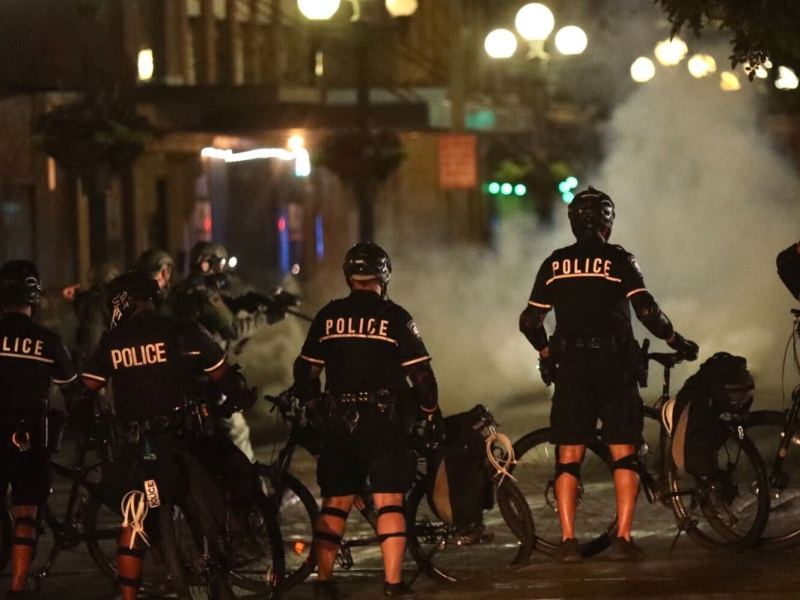 Protesters who walked to Alamo Plaza late Tuesday night were met with tear gas and projectiles after a brief stand-off with police.