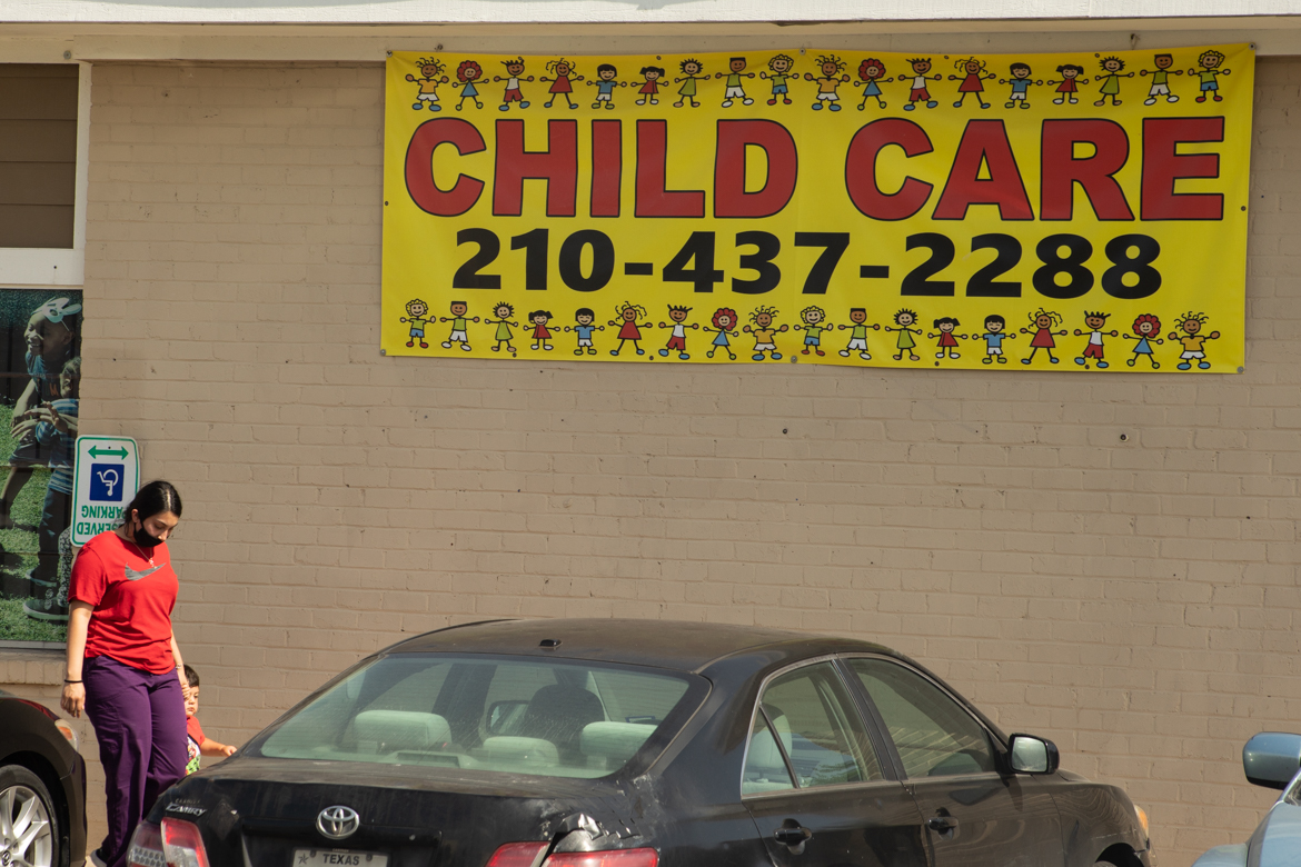 A woman leaves Books & Bibs child care and learning academy. Lack of access to child care is proving a barrier for those seeking employment.