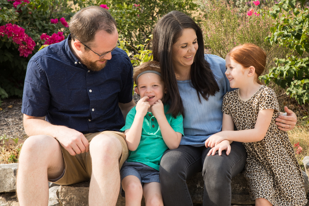 Griffin and Whitney Weaver laugh with their children, 3-year-old Gideon (center) and Harper, 5. The Weaver children attend Sunshine Cottage School for Deaf Children.