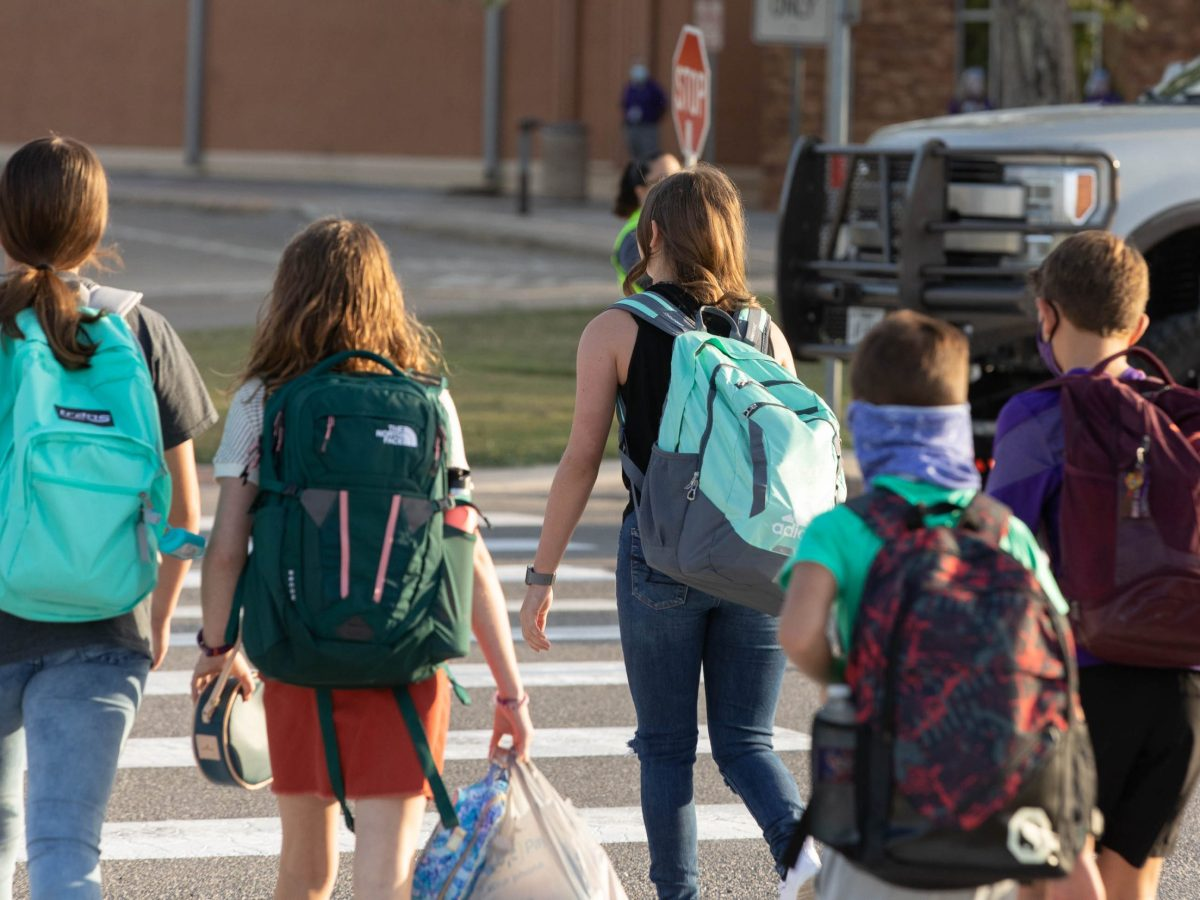 Students arrive at Boerne Middle School North on the first day of school.