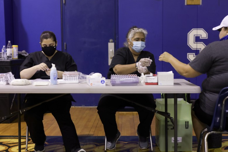 Community Labs technicians prepare tests for Somerset High School employees to self-administer a nasal swab for COVID-19 in September, 2020.