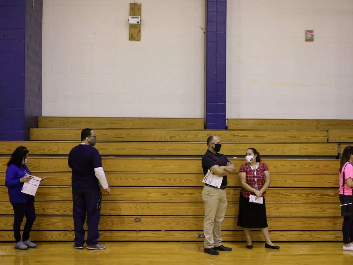 Staff members of Somerset High School wait in line to be tested for COVID-19.