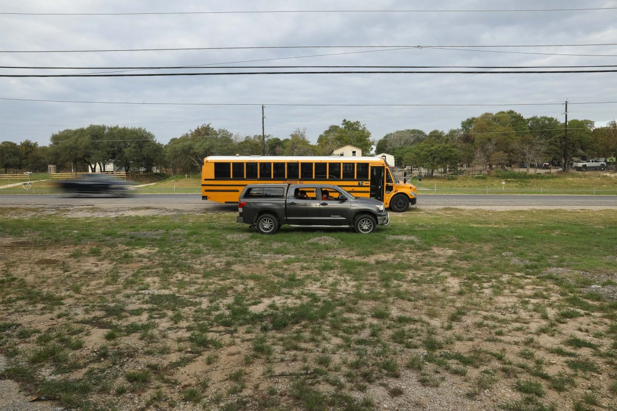 A parked school bus along U.S. Highway 281 provides Wi-Fi that connects students throughout the Southside Independent School District to their virtual classrooms.