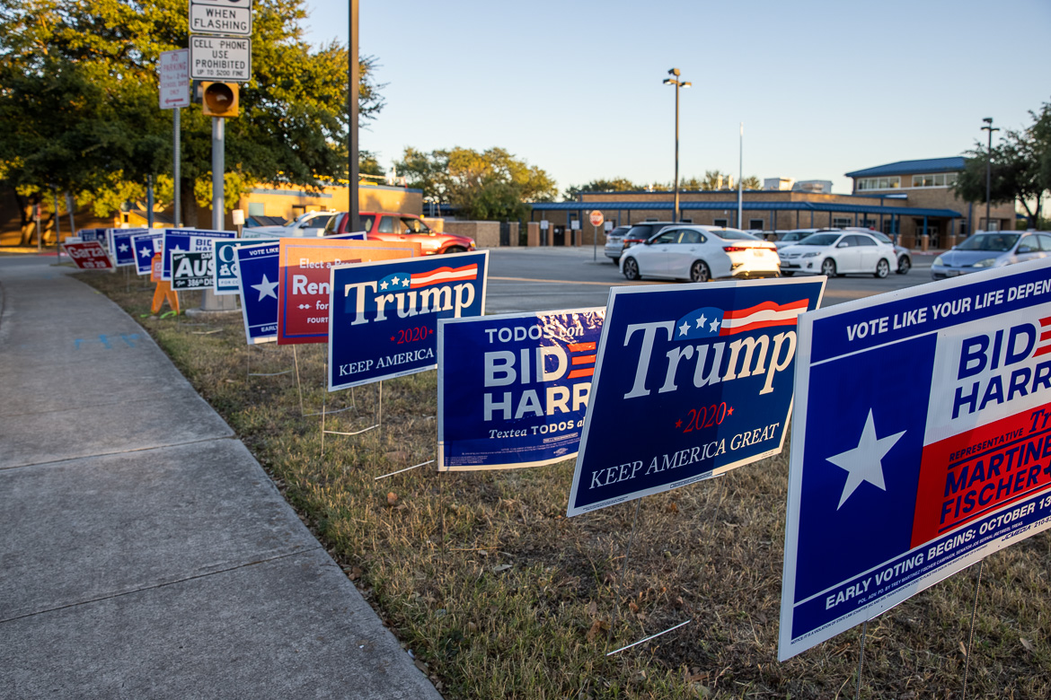 Campaign signs were lined up in front of the Oak Hills Terrace Elementary School polling location on Election Day.
