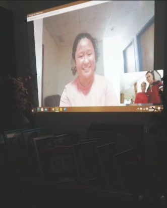 Marian Mae Cedeño is projected on her family's wall in the Philippines during their virtual Christmas celebration.