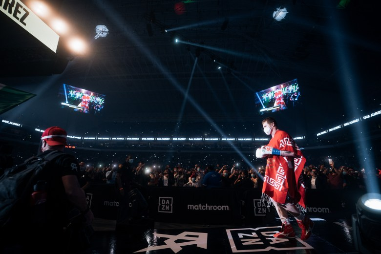 Boxer Canelo Alvarez walks toward the ring before his fight against Callum Smith at the Alamodome on Dec. 19.