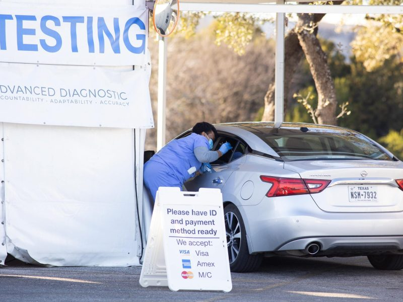 Drive-thru testing is administered recently on the North Side. Officials reported record numbers of new coronavirus cases and hospitalizations Sunday.
