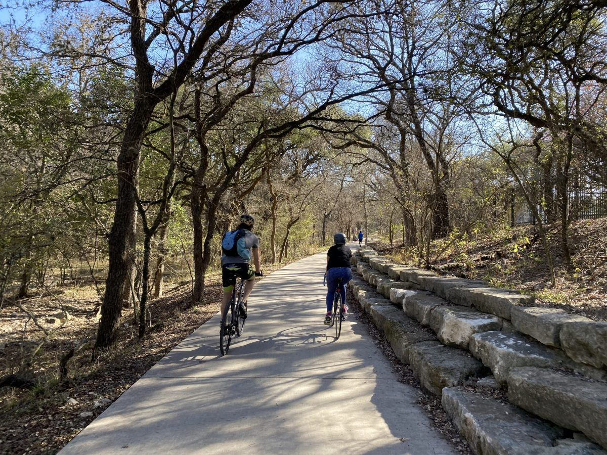 From left, Brendan Gibbons and Emily Royall ride southward along the Salado Creek Greenway trail.
