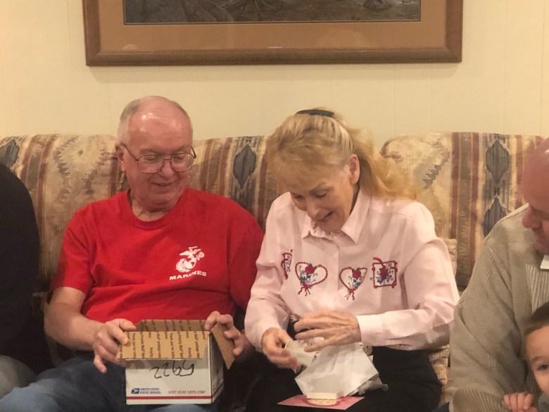 Robert (left) and Karen Autenrieth open up Karen's ring after having lost it for 48 years.