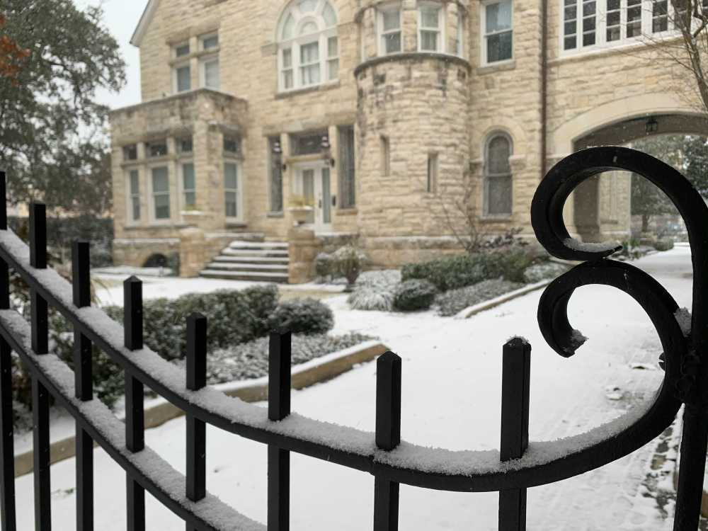 The historic Maverick Carter House is blanketed with snow Thursday morning.
