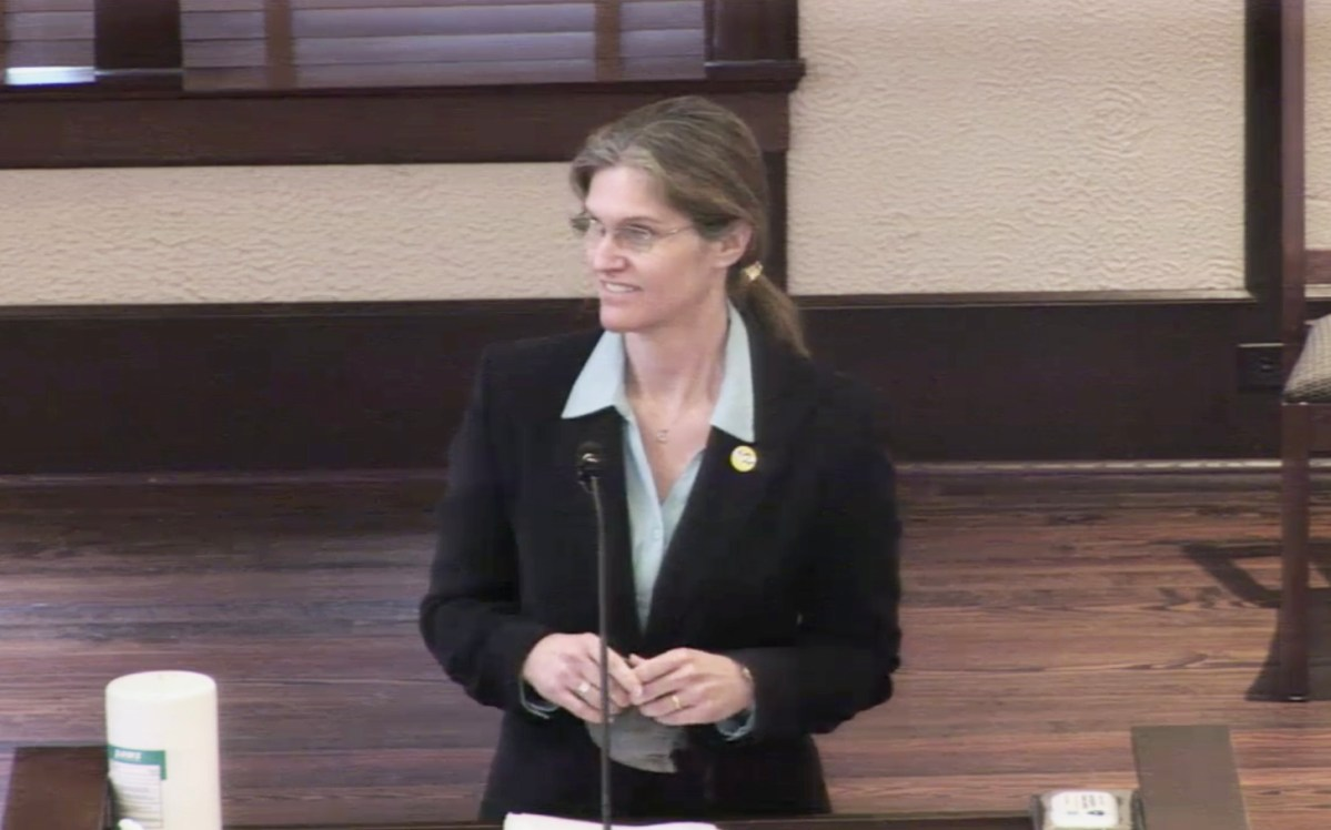 Chief Medical Examiner Dr. Kimberley Molina addresses county commissioners at their Tuesday meeting.
