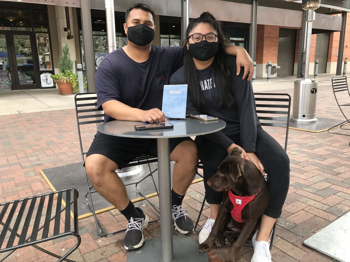 Erick Hernandez (left) and Andi Silva spend time at the Pearl with their dog Charlie. They plan to go out to a sushi restaurant on Valentine's Day.