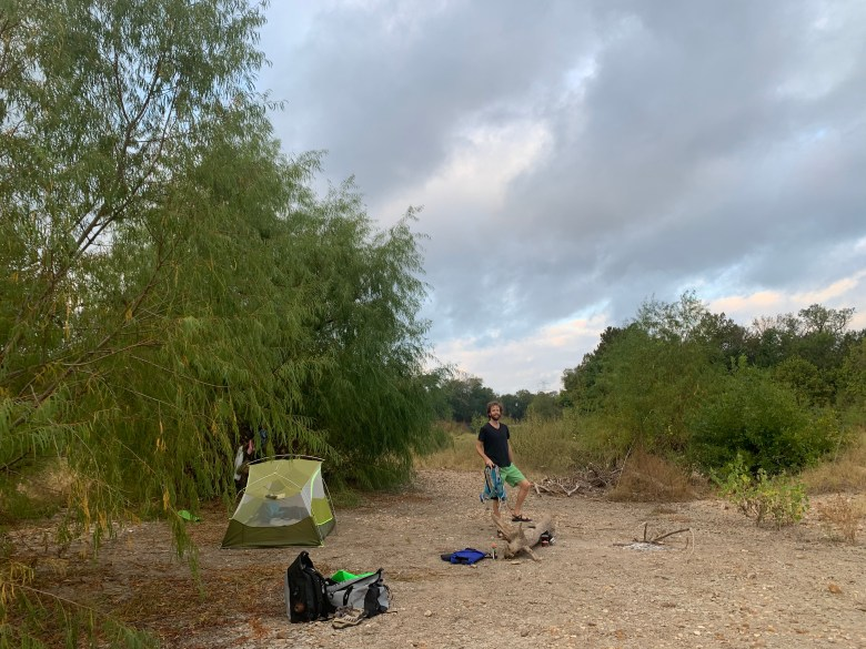 Brendan Gibbons stands on a gravel island in the Colorado River used as a campsite.